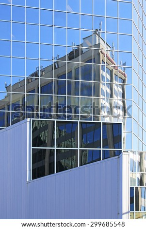 HAMILTON, ONTARIO - JULY 20, 2015: Reflections of commercial building, Hamilton. Hamilton is the centre of a densely populated and industrialized region at the west end of Lake Ontario  - stock photo