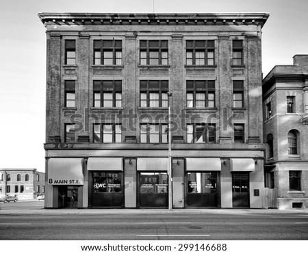 HAMILTON, ONTARIO - JULY 20, 2015:Victorian commercial building of Hamilton. Hamilton is the centre of a densely populated and industrialized region at the west end of Lake Ontario  - stock photo