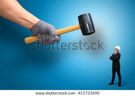 Hammer Against Business Man - stock photo