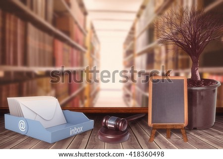Hammer and gavel against close up of a bookshelf - stock photo