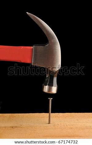 Hammer and nail - stock photo