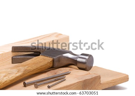 hammer and nail isolated on wood brick