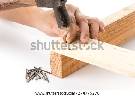 hammer and nail with wood