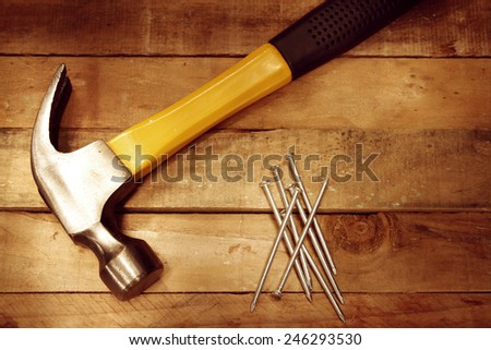 Hammer and nails on wood  - stock photo