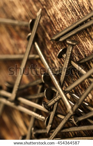 Hammer and nails on wood background/ Work tools