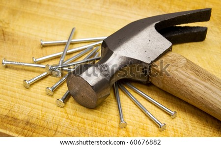 Hammer and nails on wooden board