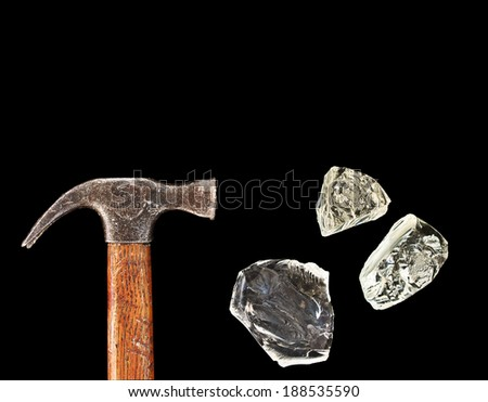 Hammer and pieces of glass isolated on black background - stock photo