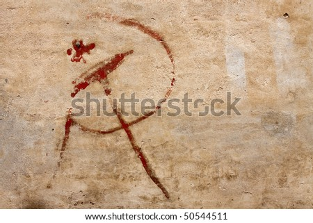 Hammer and sickle painted on a wall. Horizontal version.