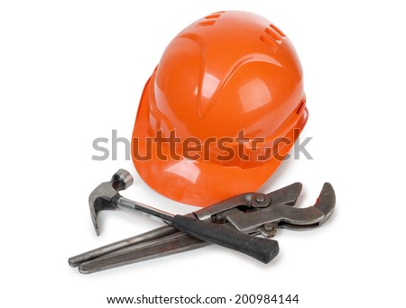 Hammer and wrench on white background