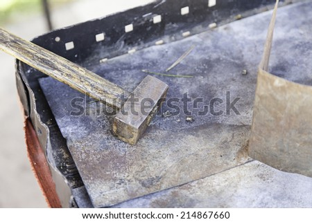 Hammer hitting metal, detail of a tool for blacksmiths