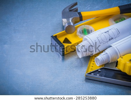 Hammer measuring line construction plans and level square ruler on industrial metallic background maintenance concept. - stock photo