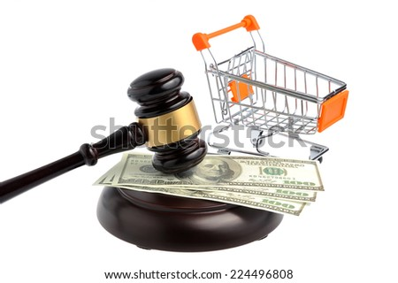Hammer of auctioneer with pushcart and dollars isolated on white background - stock photo