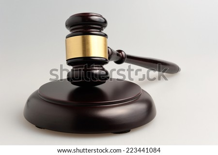 Hammer of judge on gray - stock photo
