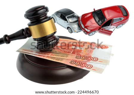 Hammer of judge with money and toy cars isolated on white background - stock photo