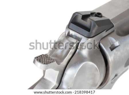 Hammer on a stainless revolver isolated on white