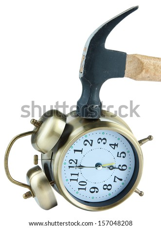 Hammer on alarm clock isolated on white - stock photo