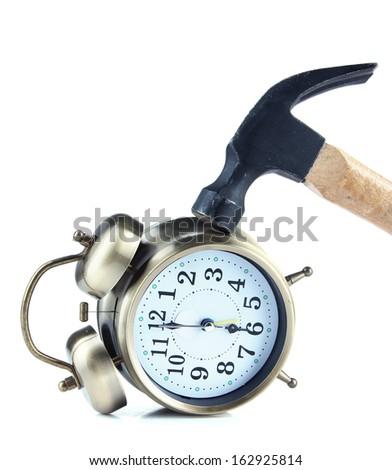 Hammer on alarm clock isolated on white - stock photo