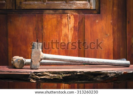 Hammer on wooden background with copy space