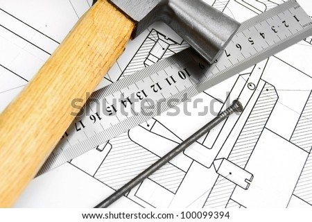 Hammer, ruler and nail on the drawing. - stock photo