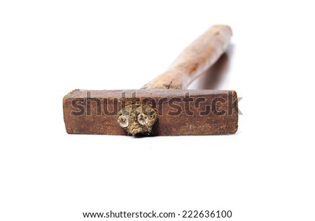 Hammer with rusty nails - stock photo