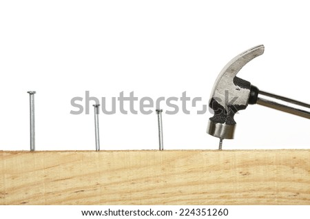 hammering consecutive nails on wood - stock photo