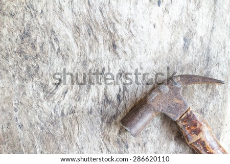 Hammers on an old wooden board - stock photo
