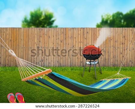 hammock and bbq at backyard - stock photo