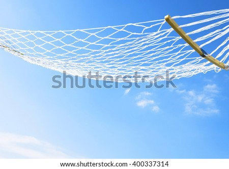 hammock hanging between two palms