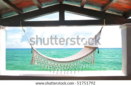 Hammock in front of Tropical ocean.