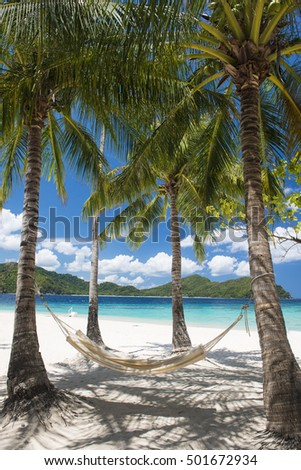 Hammock on a beautiful tropical beach