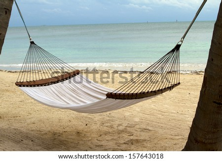 Hammock on beach - stock photo