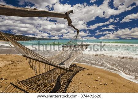 Hammock on the shore of the sea. - stock photo
