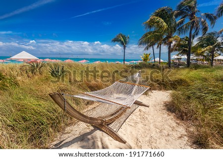 Hammock sits in the dunes on Grace Bay Beach, Turks and Caicos - stock photo