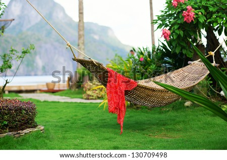 Hammock with red pareo on a tropical resort - stock photo
