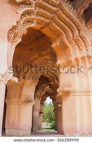 Hampi, India. Admiring the detail at the Lotus Mahal - queens mansion in Hampi - stock photo
