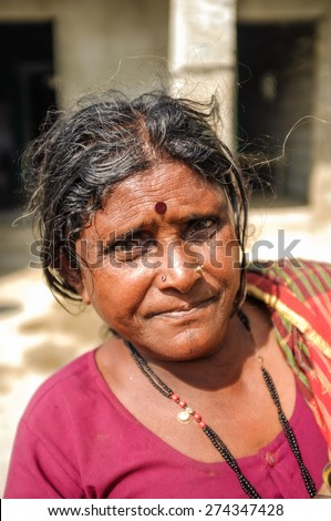 HAMPI, INDIA - 01 FEBRUARY 2015: Indian middle-aged woman with bindi on street infront of home - stock photo