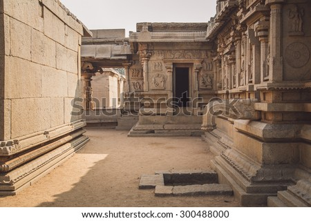 HAMPI, INDIA - 30 JANUARY 2015: Ruins of Hampi are a UNESCO World Heritage Site. Post-processed with grain, texture and colour effect. - stock photo
