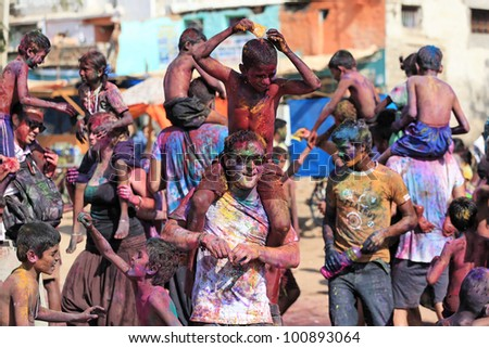 HAMPI, INDIA - MARCH 9: Unidentified people celebrate Holi festival in Hampi, India, March 9, 2012. It is a religious spring holiday and also known as Festival of Colours. - stock photo