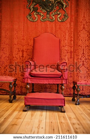HAMPTON COURT, UK - AUGUST 03, 2014 - Red throne inside Hampton Court Palace near London, UK on August 03, 2014 - stock photo