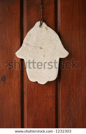 hamsa hand amulet, used to ward off the evil eye in mediterranean countries - stock photo