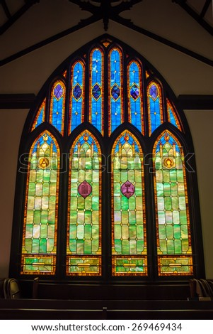 Hanalei, Hawaii - February 6, 2015 - Beautiful stained glass window inside of the Wai`oli Hui`ia United Church of Christ in Hanalei on the Hawaiian island of Kauai on February 6, 2015 - stock photo