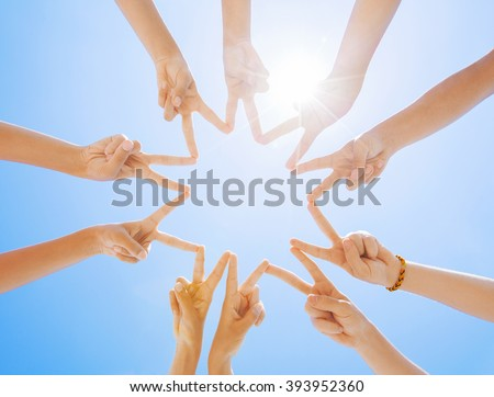 hand a group of people gathered together in the form of stars - stock photo