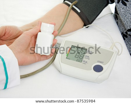 Hand an elderly woman with a sphygmomanometer on a white background.