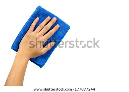 Hand and blue rag cleaning wall - stock photo
