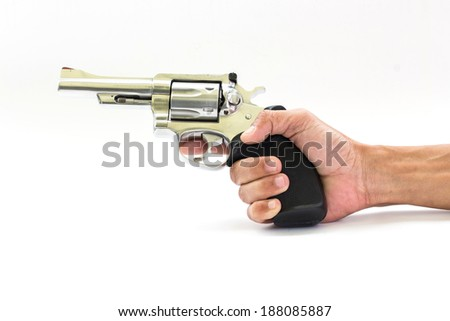 hand and chrome gun .38 mm and bullets white background