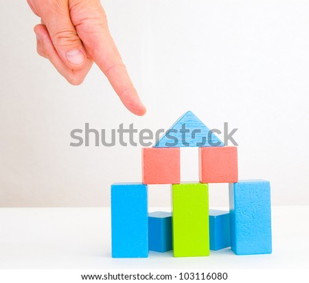 hand and colorful blocks