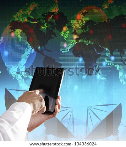hand and computer tablet with modern office building background use for modern business and city life style