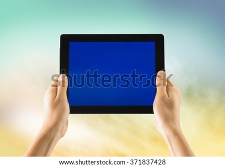 Hand and digital tablet. - stock photo