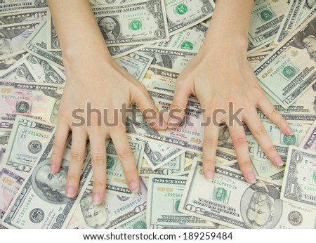 Hand and dollars as background - stock photo