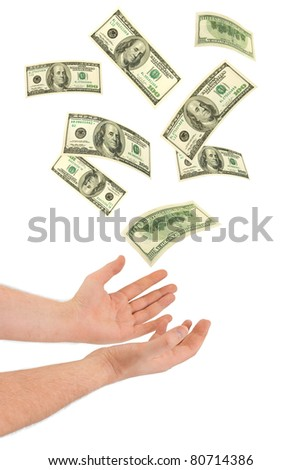 Hand and falling money isolated on white background